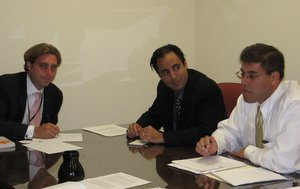 William Burke-White with Tobin scholars Deepak Malhotra and Jeremi Suri at a 2010 meeting.