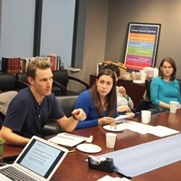 Participants in the 2015 Graduate Student Fellowship and Workshop discuss their research.